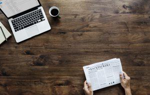 coffee laptop newspaper